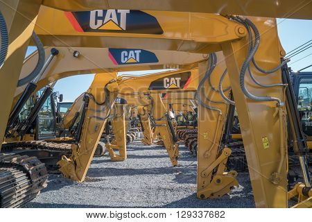 Litiz, PA USA - April 23, 2016: Caterpillar heavy equipment lined up at Caterpillar dealer. Caterpillar is one of the largest manufacturers of heavy construction & mining equipment in the world.
