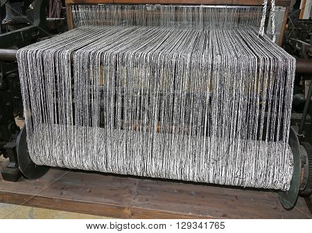 Old Last Century Loom For The Production Of The Fabrics In The Textile Industry With The Black And W