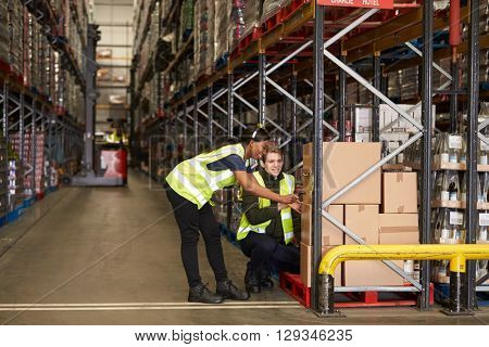 Staff identifying boxes in a distribution warehouse