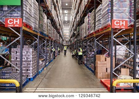 An aisle between storage units in a distribution warehouse