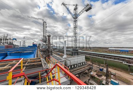 Chemical plant for production of ammonia and nitrogen fertilization on day time. Giant crane at the plant