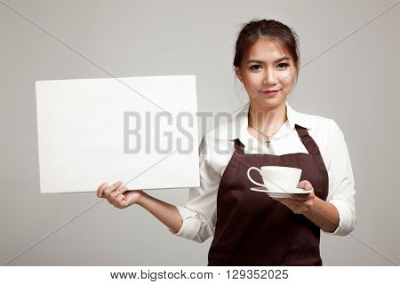 Waitress Or Barista  In Apron  Holding Coffee And Blank Sign