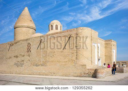 Buckara Uzbekistan - Aprilr 16 2014: Local peoplr at the entrance of the Chashma Ayub mausoleum