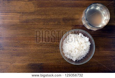 fungus - zooglea 'Indian Maritime rice' in a glass plate on a wooden background. Infusion of sea rice. Features: Immunomodulatory; Hypotensive (lowers blood pressure); Anti-sclerotic; Antimicrobial; Metabolic (improves metabolism); Diuretic.