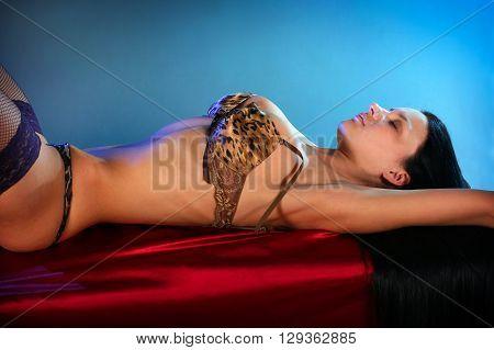 Beautiful sexy brunette girl in black nylon stockings