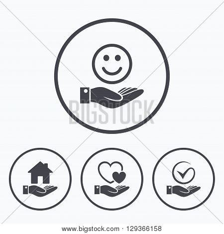 Smile and hand icon. Heart and Tick or Check symbol. Palm holds house building sign. Icons in circles.