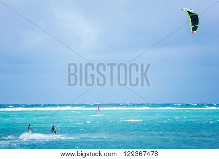 Boracay island, Philippines - January 25: two kiteboarders using rope tow while riding near Bulabog beach on January 25, 2016, Boracay island, Philippines.