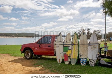 KALBARRI,WA,AUSTRALIA-APRIL 18,2016: Murchison River and river mouth foreshore with red truck renting surf boards and people in Kalbarri, Western Australia.