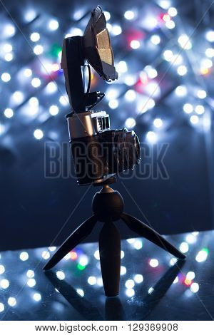 Retro camera and tripod with fairy lights