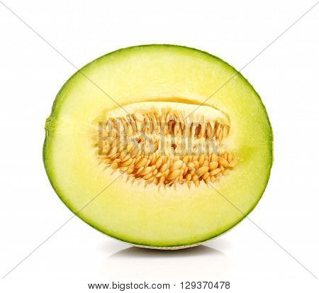 Melon cut half isolated on white background.