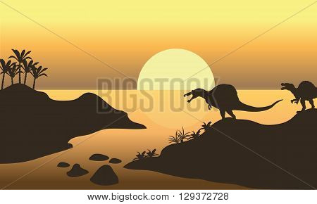 Silhouette of spinosaurus in riverbank at the afternoon