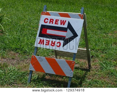 A sign showing directions for a film crew to the shoot location.