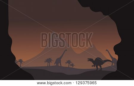 Silhouette of spinosaurus and brachiosaurus in the hills