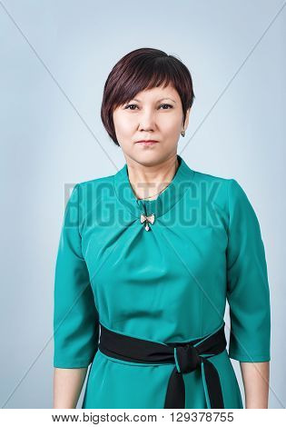 Attractive adult suspicion woman on the gray background