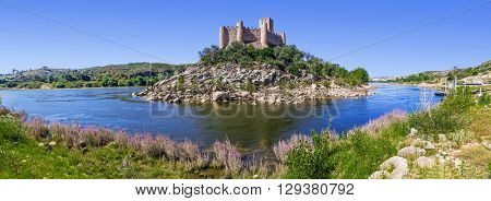 Panorama of the Templar Castle of Almourol and Tagus river. One of the most famous castles in Portugal. Built on a rocky island in the middle of Tagus river.