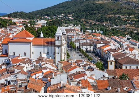 View of the Santa Maria da Devesa church and Dom Pedro V square seen from the Castle Tower. Castelo de Vide, Alto Alentejo, Portugal.