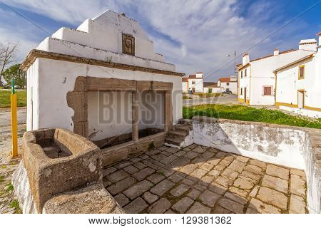 The Fonte Branca (White Fountain), a 15th century fountain in Flor da Rosa near the Monastery. Crato, Alto Alentejo, Portugal.