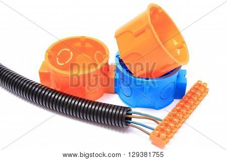 Corrugated plastic pipe electrical cable with connection cube and electrical box component for use in installations. Isolated on white background