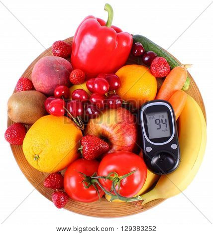Glucose meter with fresh fruits and vegetables lying on wooden plate concept of diabetes healthy food nutrition and strengthening immunity