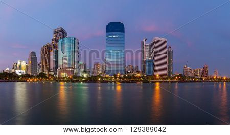 Benjakiti Park,Bangkok,Thailand - May 8, 2016 : building and the lake View from Benjakiti Park in evening time