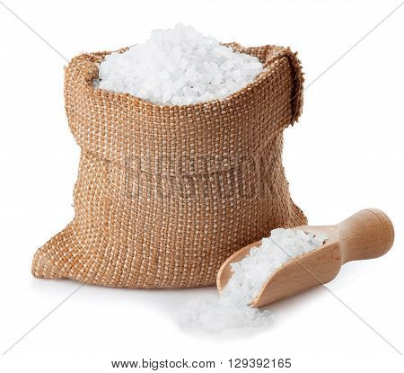 Sea salt in burlap bag with wooden scoop isolated on white background. Condiment crystals of sea salt