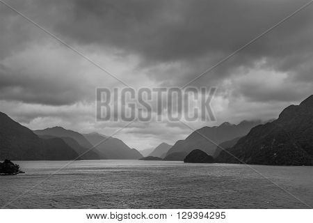 Fiordland National Park Scenic in rainy weather with dramatic sky - Park occupies the southwest corner of the South Island of New Zealand - black and white photography