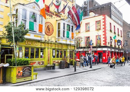 DUBLIN, IRELAND - MAY 05, 2016: Tourists walking in the Temple Bar area. The place is the cultural quarter in the center of the city and is full of restaurants bars and nightclubs.