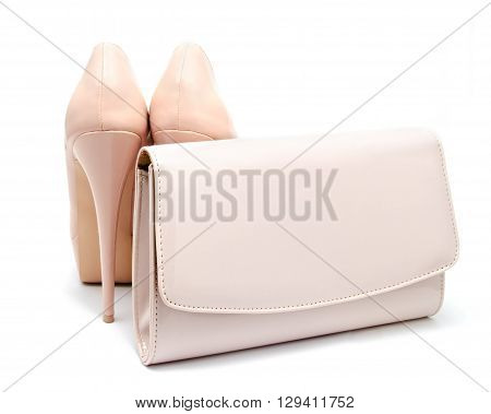 Biege high heel woman shoes and clutch isolated on a white