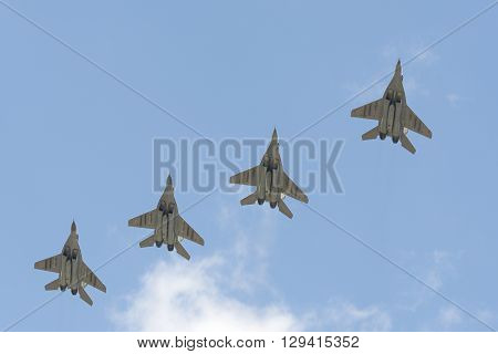Four Military Aircraft Mig-29 Flying Over The Red Square