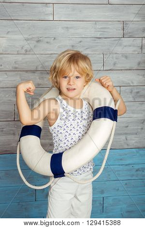 little boy dressed lifeline and shows its strength