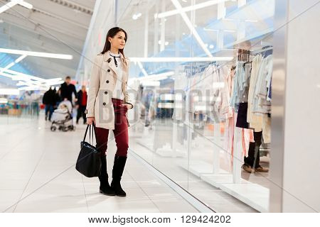 Beautiful young cute woman shopping trendy clothes