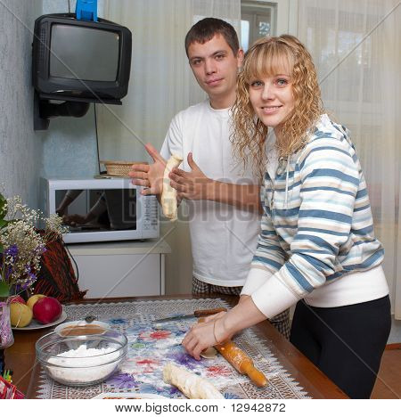 family kneads dough