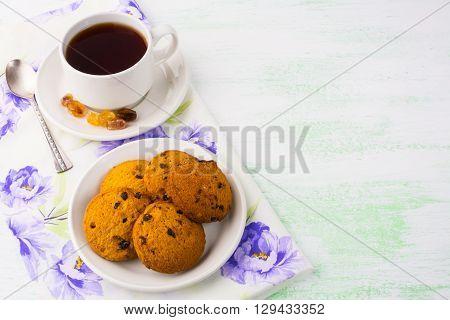 Tea cup and cookies on light green background copy space. Cup of tea. Tea cup. Tea party. Breakfast tea. Homemade biscuit. Homemade cookies.