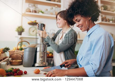 Two Women Preparing Fruit Juice At Cafe