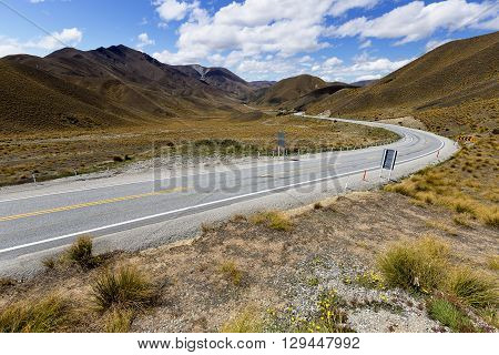 Highway that cuts through Lindis Pass, New Zealand.