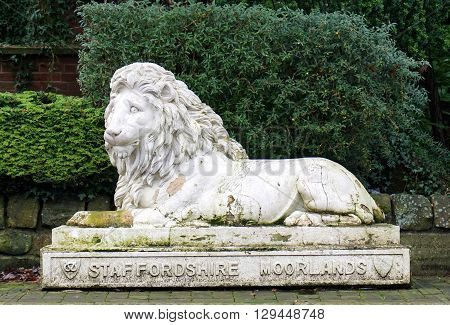 LEEK, UK - DECEMBER 31: A decaying statue of a seated lion in Leek, England displays the crest of the Staffordshire Moorlands on December 31, 2015.