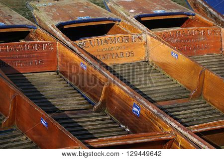 CAMBRIDGE, UK - FEBRUARY 24: Several punts belonging to Scudamore's punting company, Cambridge, England, sit empty on a slow tourism day in winter on February 24, 2016.