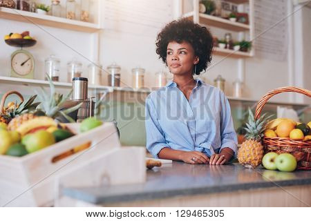 Confident Young Female Juice Bar Employee