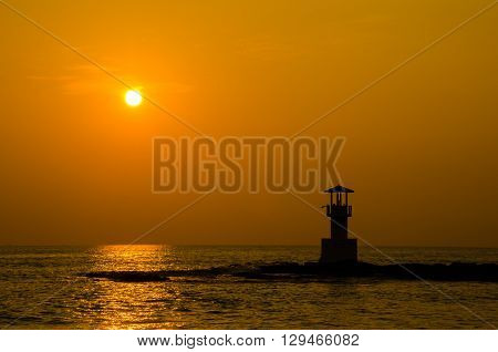 Silhouettes of lighthouse at ocean Khao Lak beach Phangnga Thailand.