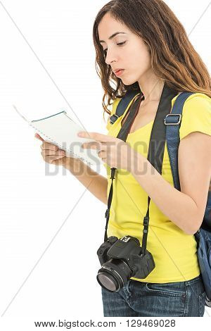Caucasian tourist woman reading a tourist guide. Isolated on white background.