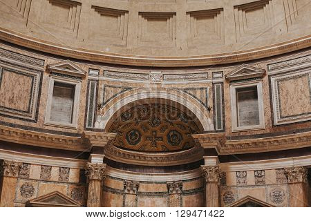 Rome, Italy - April 22, 2016: Inside view detail of Pantheon with tourist walking around on April 22, 2016 in Rome, Italy.