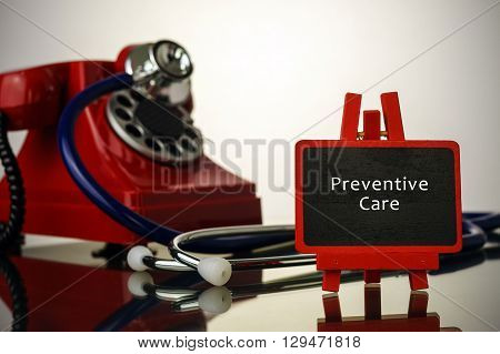 Medical Concept.phone And Stethoscope On The Table With Preventive Care Words On The Board.