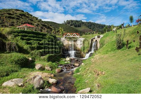 Artificial waterfall with blue sky in Cameron Highlands Malaysia.