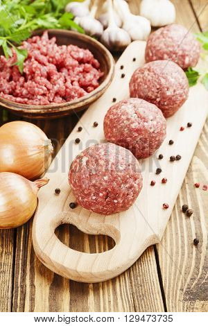 Raw Meatballs On The Table