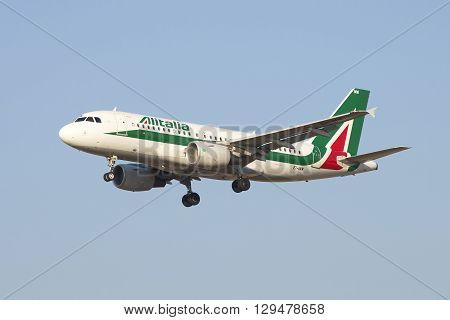 SAINT PETERSBURG, RUSSIA - MARCH 28, 2016: The Airbus A319-111 ( EI-IMW) Alitalia is landing in Pulkovo airport