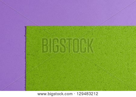 Eva foam ethylene vinyl acetate sponge plush apple green surface on light purple smooth background