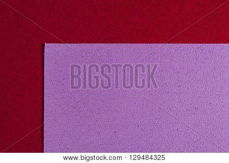 Eva foam ethylene vinyl acetate light purple surface on red sponge plush background