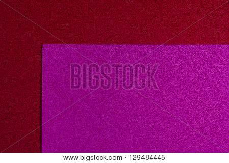 Eva foam ethylene vinyl acetate pink surface on red sponge plush background