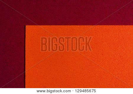 Eva foam ethylene vinyl acetate orange surface on red sponge plush background
