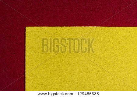 Eva foam ethylene vinyl acetate lemon yellow surface on red sponge plush background